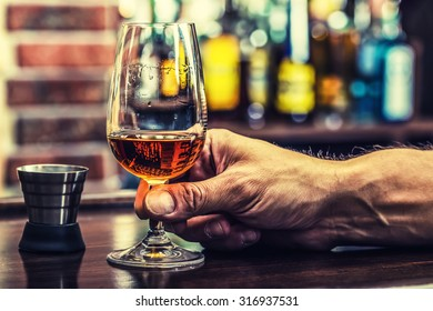 Hand alcoholic and drink the distillate brandy or cognac.