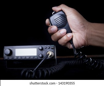hand of Amateur radio holding speaker and press for radio communication theme