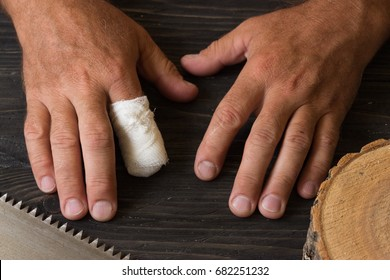 Hand with an amputated index finger. Safety in the workplace. Provision of first aid. Work with dangerous tools.