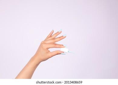 Hand applying nail polish beauty nails light blue  - Shutterstock ID 2013408659
