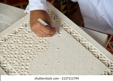 Hand of an arabian male gypsum carver close up. Stonecutter at work. Qatar
