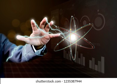 Hand and arm of power businessman with lightning thunder in concept of magical power of business information technology