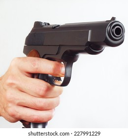 Hand with a army semi-automatic gun close up