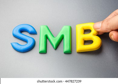 Hand arrange alphabet letters as SMB, abbreviation of Small and Medium Sized Business
