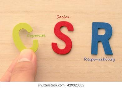 Hand arrange letters as CSR (Coporate , Social , Responsibility)