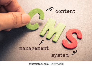 Hand arrange wood letters as CMS (Content Management System)