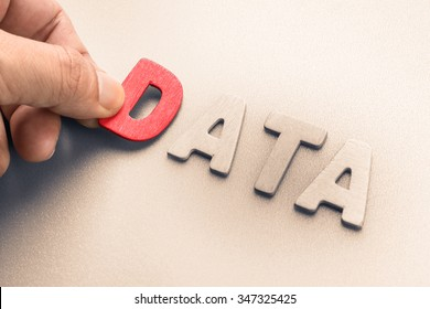 Hand arrange wood letters as Data word