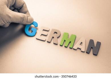 Hand arrange wood letters as German word