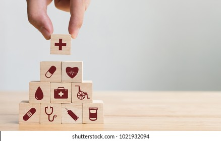 Photo of Hand arranging wood block stacking with icon healthcare medical, Insurance for your health concept