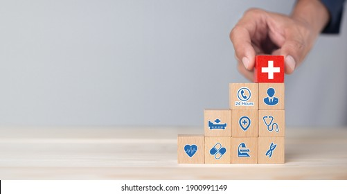 Hand arranging wood block stacking with icon healthcare medical, Health insurance - concept.
