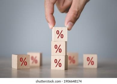 Hand arranging wood block stacking with icon percent symbol upward direction,
