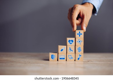 Hand arranging wood block stacking with icon healthcare medical, Insurance for your health medical, Insurance for your health concept.