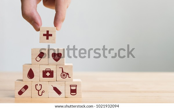 Hand arranging wood block stacking with icon healthcare medical, Insurance for your health concept