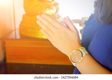 Hand of Asian women pay respect to the Buddha.Close up.