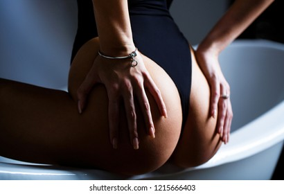 Hand of the ass. Sexy ass, sensual woman body. Female ass in panties. Woman butt without cellulite. Bikini underwear. Big sexy buttocks. Naked girl, sexy nude woman. Hands of the butt. Plastic surgery