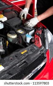 Hand of auto mechanic. Car repair service.
