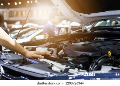 Hand of auto mechanic with a wrench. Car repair