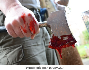Hand axe with dripping blood