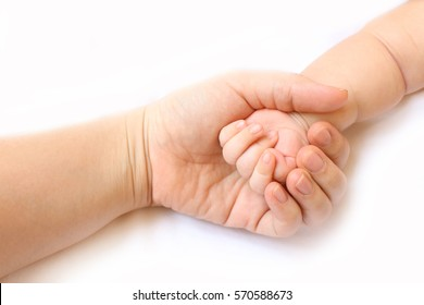 hand baby in the hand of mother