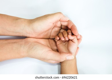 The hand of baby in the hand of mother