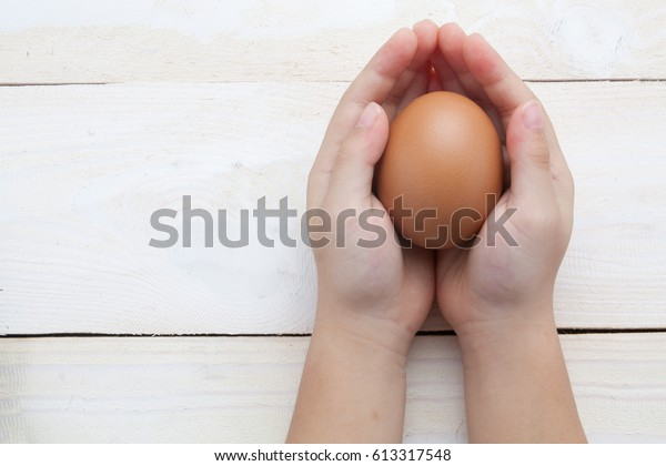hand balancing eggs chicks  are born with take care