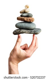 Hand balancing the zen stone pyramid