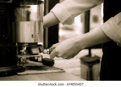 Hand of Barista making Coffee with coffee machine in the coffee shop. people with barista in cafe concept. vintage tone.