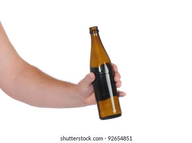 Hand with beer bottle in front of a white backgroun