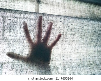 The hand behind the black curtain, Show the feeling of panic.