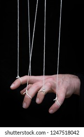 A hand being controlled as if it is a puppet.
