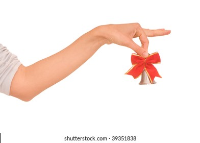 hand bell with red bow in the woman's hand