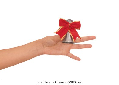 hand bell with red bow in the woman's hand for ringing