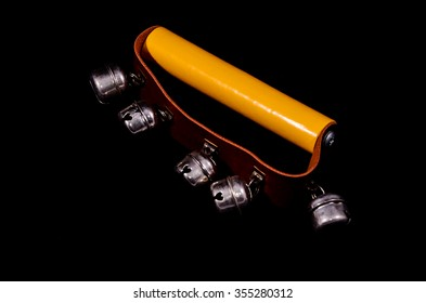 Hand bells musical instrument for ringing on a black background