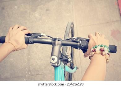 Hand with bike