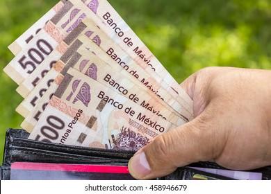 Hand with bills