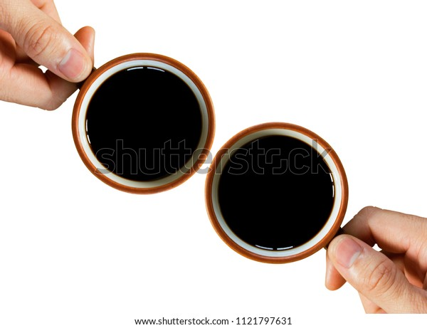 Hand and black coffee isolated on white background. Top view. Free space for text.