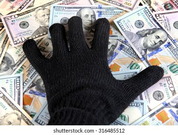 Hand in Black Glove on the American Dollars Background