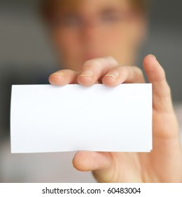 hand and blank paper with copyspace for your text message