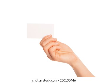 in hand a blank sheet of white paper shown up. Isolated, over white background.