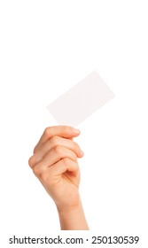 in hand a blank sheet of white paper held diagonally. Isolated, over white background.