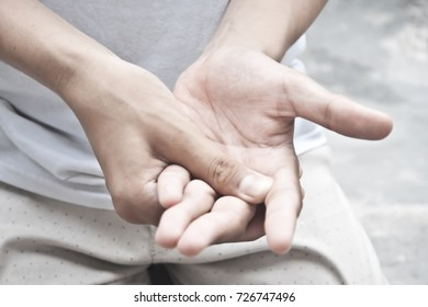 A hand blocking another hand to do mischiefs.