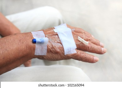 hand and blood test tube