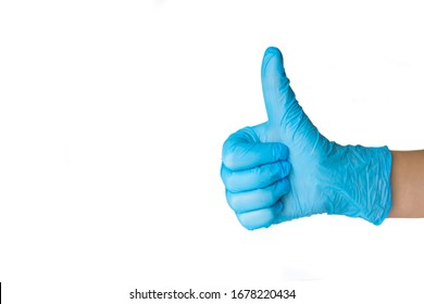 Hand in blue glove with thumb up on a white background.