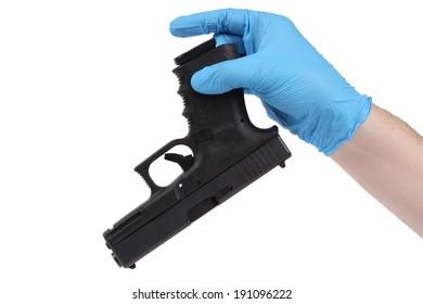 Hand in blue latex glove keeps handgun as evidence