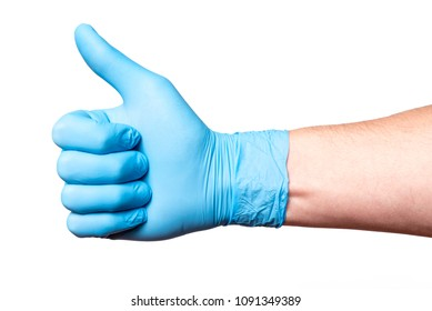 Hand in blue medical glove shows thumbs up