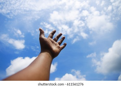 hand and blue sky as a background