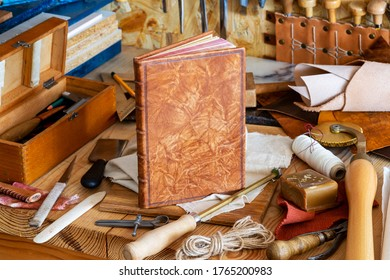 Hand bookbinding. Bookbinding Tools. Close up.