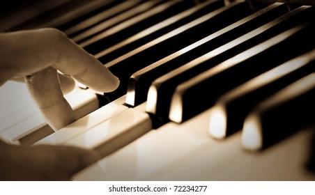 A hand of a boy playing piano