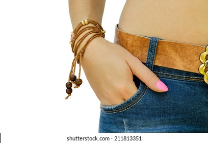 hand with a bracelet in a pocket of jeans