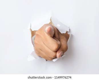 Hand breaking through paper pointing at you